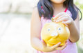 Little hand put coin to piggy bank Royalty Free Stock Photo