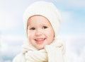 Little happy baby child girl in white hat in  winter Royalty Free Stock Photo