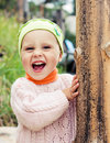 Little happy baby walking outdoors Stock Images