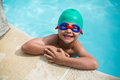 Little happy boy leaning at poolside Royalty Free Stock Photo