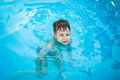 Little happy boy in pool floating Stock Photo