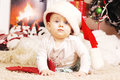 Little happy christmas girl in santa s hat red Stock Photo