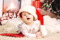 Little happy christmas girl in santa s hat red Royalty Free Stock Photography
