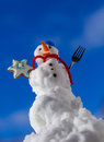 Little happy christmas snowman with cookie star outdoor. Winter season.