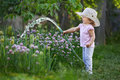 Little happy gardener watering onions Royalty Free Stock Photo