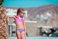 Little happy girl enjoy vacation near outdoor swimming pool Royalty Free Stock Photo