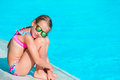 Little happy girl enjoy vacation in outdoor swimming pool Royalty Free Stock Photo
