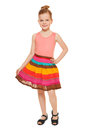 Little happy girl full lenght in colorful skirt, isolated on white background Royalty Free Stock Photo