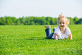 Little happy girl on a grass Royalty Free Stock Images