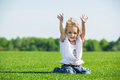 Little happy girl on a grass Royalty Free Stock Image