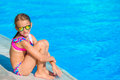 Little happy girl in outdoor swimming pool enjoy her vacation Royalty Free Stock Photo