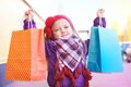 Little happy girl with purchases in hands fun Stock Image