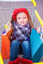 Little happy girl with purchases in hands this image has attached release Royalty Free Stock Images