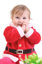 Little happy girl in red santa's clothes Stock Image