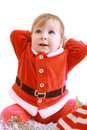 Little happy girl in red santa's clothes Royalty Free Stock Photo