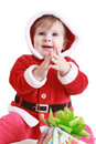 Little happy girl in red santa's clothes clapping Stock Images