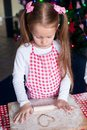 Little happy girl with rolling pin baking Royalty Free Stock Photo