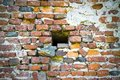 Little hole in an old brick wall Royalty Free Stock Photo