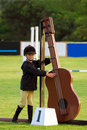 Little horse riding girl a cute preteen caucasian horseback rider in her outfit playing with one of the jump decorations cello Stock Photos