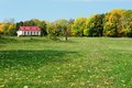 Little house on green summer meadow in Spasskoye-Lutovinovo Royalty Free Stock Photo