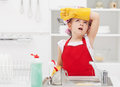 Little housekeeping fairy tired of home chores girl doing the dishes Royalty Free Stock Images