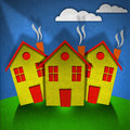 Little houses made in velvet three small stylized on green hill and blue sky with clouds textile material Stock Image