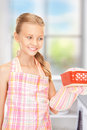 Little housewife bright picture of cooking girl over white Royalty Free Stock Photo