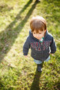 Little infant walking golden hour Stock Image