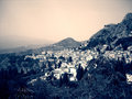 Little Italian town of Taormina at the foot of Mount Etna in black and white; dramatic retro style Royalty Free Stock Photo