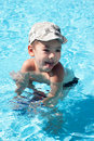 Little joy boy swims in the sea Stock Image