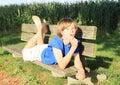Little kid - boy on a bench