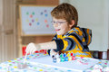 Little kid boy drawing with colorful watercolors indoors Royalty Free Stock Photo