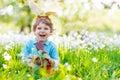 Little kid boy eating chocolate Easter bunny