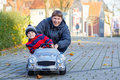 Little kid boy and father playing with car, outdoors Royalty Free Stock Photo