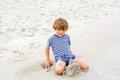 Little kid boy having fun with building sand castles Royalty Free Stock Photo