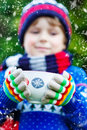 Little kid boy holding big cup with chocolate funny child snowflakes and hot cocoa and drink and marshmallows in winter sweater Royalty Free Stock Photos