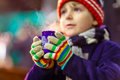 Little kid boy with hot chocolate on Christmas market Royalty Free Stock Photo