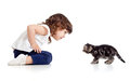 Little kid and cat looking at each other on white Royalty Free Stock Photo