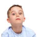 Little kid with funny surprised expression isolated on white Royalty Free Stock Image