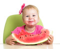 Little kid girl eating watermelon at table Royalty Free Stock Photo