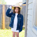 Little kid girl pretending to be a cowboy with father hat and jacket Royalty Free Stock Image