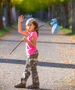 Little kid with hobo stick bag and bundle girl saying goodbye hand Royalty Free Stock Images