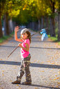 Little kid with hobo stick bag and bundle girl saying goodbye hand Stock Images