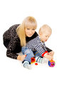 Little kid with my mom plays with toys Royalty Free Stock Image