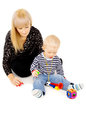 Little kid with my mom plays with toys Royalty Free Stock Photos