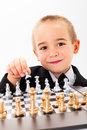 Little kid opening chess game wise child player Royalty Free Stock Photos