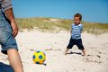 Little Kid Playing Football with Dad Stock Image