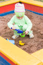 Little kid playing in a sandbox Stock Photos