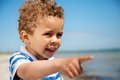 Little Kid Pointing at Something Interesting Royalty Free Stock Photos