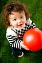 Little kid with a red ball Royalty Free Stock Image